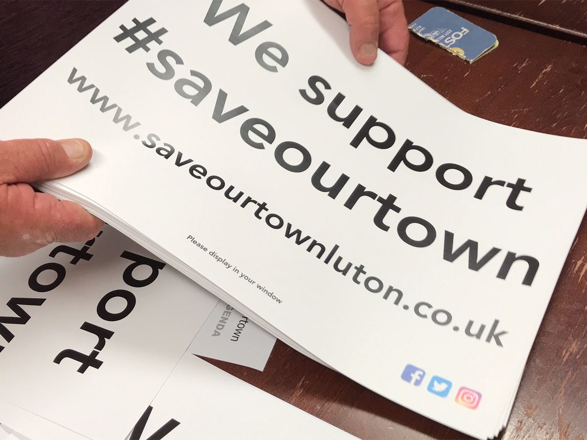 #saveourtown Posters being printed