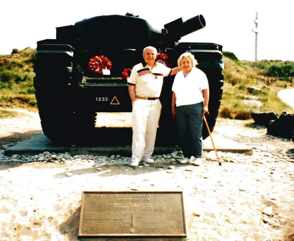 Doug and Brenda on Juno Beach in Normandy, in front of a Churchill tank